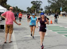 Passing the Parrot Heads during the Miami Marathon. Stock Photo