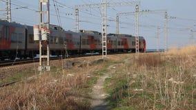 Passing passenger train. The Russian Railways. Cochi, Russia - Much 23, 2017: passing passenger train.The Russian Railways. The Black sea coast stock video footage