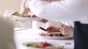 Passing Plates At Dinner Party. Close up shot of a dinner party where plates are being passed and food is being enjoyed stock footage