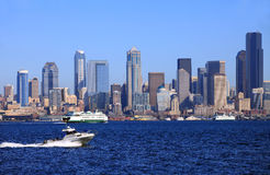 A passing power boat and the Seattle skyline. Royalty Free Stock Photography