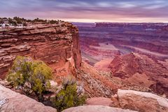 Dead Horse Point State Park. A passing rainstorm provides ominous clouds and color at sunrise, as the canyon at Dead Horse Point State Park is bathed in hues of stock photography