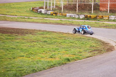Passing sharp bend. Moscow, Russia - October 9, 2016: Car number 96 driven by Kabakov passing sharp bend during Legends Russian series race at ADM Raceway royalty free stock photography