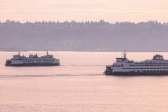 Passing Sound Transit Ferries at dusk Stock Image