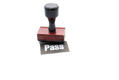 Passing stamp. A stamp with a pass mark on a white paper Stock Images