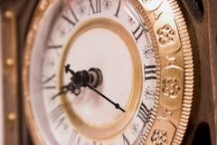 Passing time... Old wooden clock showing time, close-up Royalty Free Stock Image