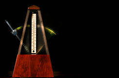 Passing Time. Wooden metronome with motion Stock Photography
