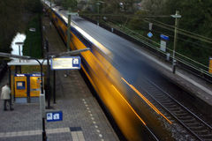 Passing train. Passing dutch train on railway station royalty free stock images