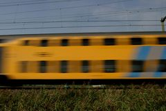 Passing train. Double-decker train passing- D-train or express train Royalty Free Stock Photo