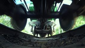 Passing train bottom view wide angle. Passing train bottom under view wide angle close-up. Railroad tracks railways train transport system fast speed stock video