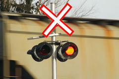 Passing Train and Crossing Indicator Stock Images