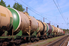 Passing train from railway tanks and empty rails Royalty Free Stock Photo
