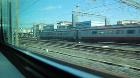 Passing in a Train from a Station of Firenze Rifredi an then cross with an High Speed Train stock footage