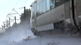Slow-mo footage. A passing train in the winter. Snowy turbulence. A passing train in the winter. Snowy turbulence stock video footage