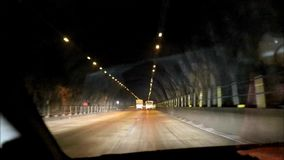 Passing through a tunnel. On Mumbai-Pune express way by a car. Timelapse stock video
