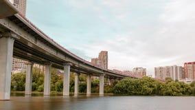 Passing under bridge hyperlapse. Passing under the river bridge in urban environment hyperlapse stock video