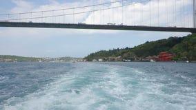 Passing under Fatih Sultan Mehmet Bridge over the Bosphorus Strait in Istanbul stock footage
