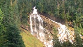 Passing by a waterfall during a train tour from Toronto to Vancouver in Canada stock video