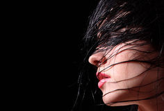 Passion. Face of the young beautiful girl with wet hair Royalty Free Stock Photos