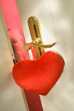 Passion. Red fabric heart at a bordello door Royalty Free Stock Images
