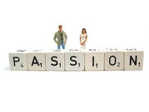 Passion. Man and woman behind the word passion Royalty Free Stock Image