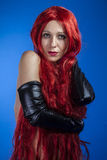 Passion, attractive woman with huge red mane, blue chroma Royalty Free Stock Photos