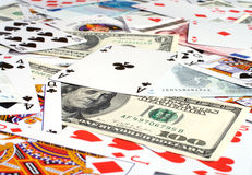 Passion a background. Background from banknotes and playing cards a close up Stock Images