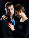 Passion couple in love. Passion couple against a dark background Stock Photos
