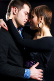 Passion couple in love. Passion couple against a dark background Royalty Free Stock Photography