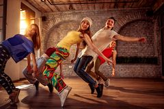 Passion dance team - urban hip hop dancer exercising dance train. Passion dance team - Group of urban hip hop dancer exercising dance training in studio royalty free stock photo