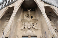 Passion façade at Sagrada Família church. Barcelona, Spain - 12 December,2015 : Passion façade to display the bones of a skeleton sculpture following stock images