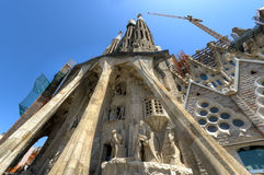 Passion facade of La Sagrada Familia. Basilica designed by Antoni Gaudi, started in 1882 and still under construction at August 04, 2013 in Barcelona, Spain Royalty Free Stock Image