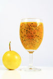 Passion Fruit. Ripe passion fruit juice in a glass royalty free stock photo