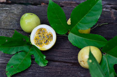 Passion fruit. On wood background Stock Photos