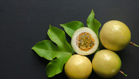 Passion fruit on black background Stock Photos