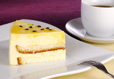 Passion-fruit Cake. With coffee (Selective Focus Royalty Free Stock Photography
