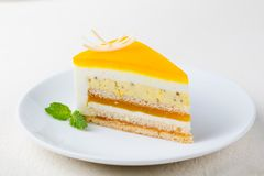 Passion fruit cake, mousse dessert on a white plate. Passion fruit cake, mousse dessert on a white plate stock images