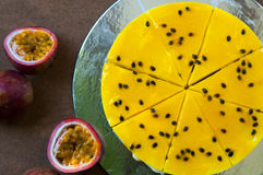Passion fruit cheesecake on the background. Yellow passion fruit cheesecake on the background Stock Images