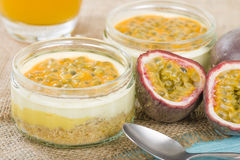 Passion Fruit Cheesecake. Individual potted dessert made with passion fruit whipped cream and a biscuit base Stock Image