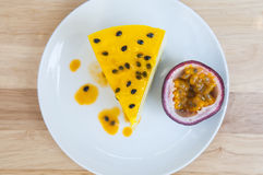 Passion fruit cheesecake. On the table Royalty Free Stock Photography