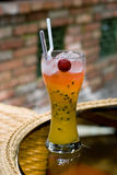 Passion Fruit Cocktail Drink. A glass of cocktail drink with straws and fruit Royalty Free Stock Images