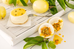 Passion fruit dessert with freshly cut maracuja or passion fruit Royalty Free Stock Image