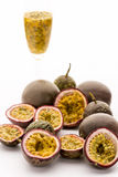 Passion Fruit Flesh In Its Rind And In A Glass. Passion fruit flesh in its purple rind and in a champagne flute. Seven halved maracuja fruits and six whole royalty free stock images