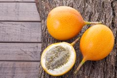 Passion fruit on the table - Passiflora ligularis. Passion fruit granadilla on the table - Passiflora ligularis royalty free stock photography