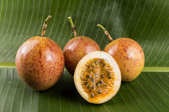 Passion fruit. On green banana leaf Stock Image