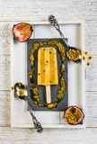 Passion fruit ice cream. Displayed in a vintage style stock images