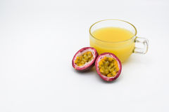 Passion fruit juice with two half passion fruit  isolated on whit. Royalty Free Stock Images