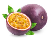 Passion fruit with leaves isolated. Passion fruit isolated. Whole passionfruit and a half of maracuya isolated on white background. Clipping path included stock photo
