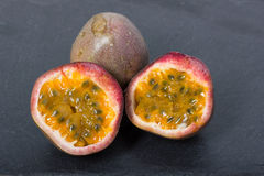 Passion fruit, maracuja. Passion fruit maracuja on black table Royalty Free Stock Photos