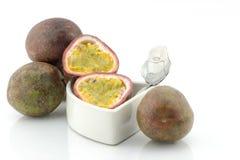 Passion fruit or maracuya, whole fruit and opened Royalty Free Stock Image