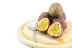 Passion fruit or maracuya, whole fruit and opened Stock Photos